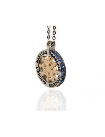 Acciaio : collana forzatina con pendente tondo timone e venti oro zirconi blu